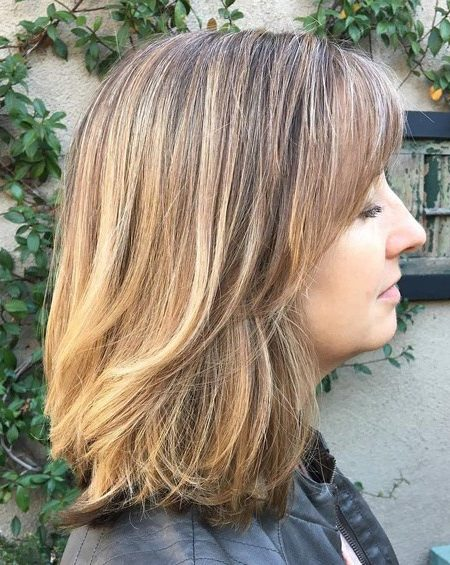 Medium-Length-Haircut-with-Bangs-450x565